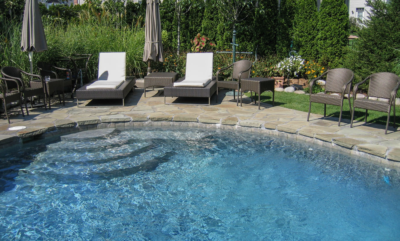 Swimming Pool Steps, Patio, And Pool Landscaping