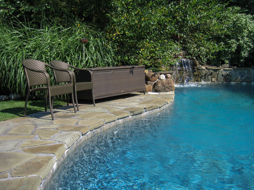 custom swimming pool, patio, and pool waterfall