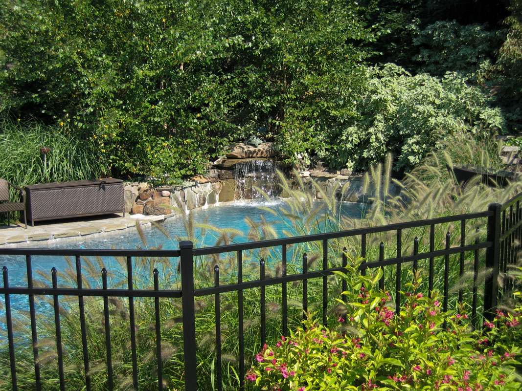 custom pool design with waterfall and landscaping