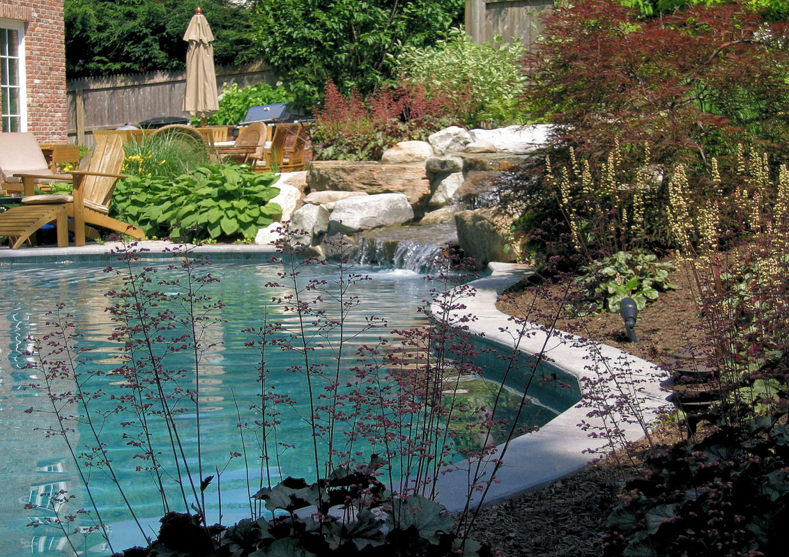 swimming pool with natural stone waterfall