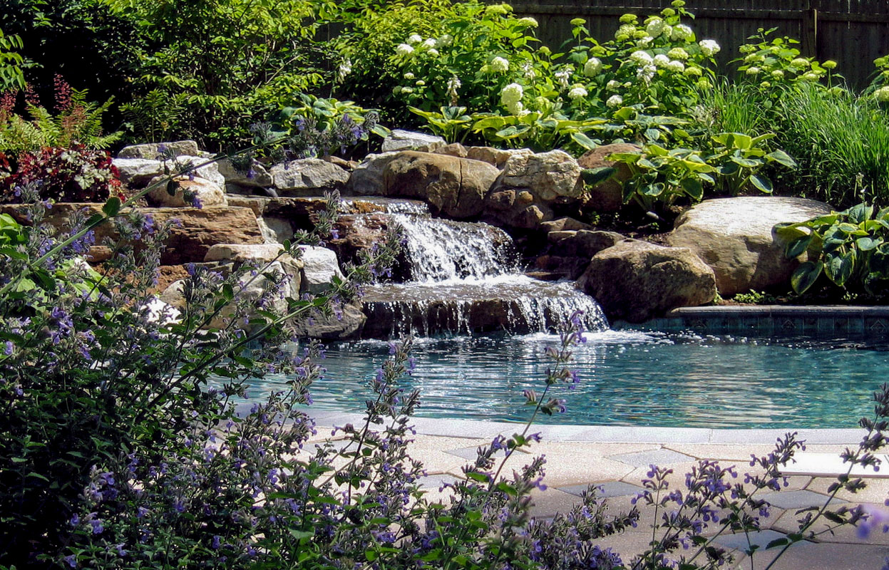 kid and pet safe natural stone pool waterfall