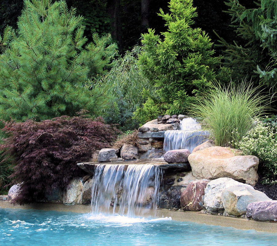 pool waterfall using natural stones, pool landscape design
