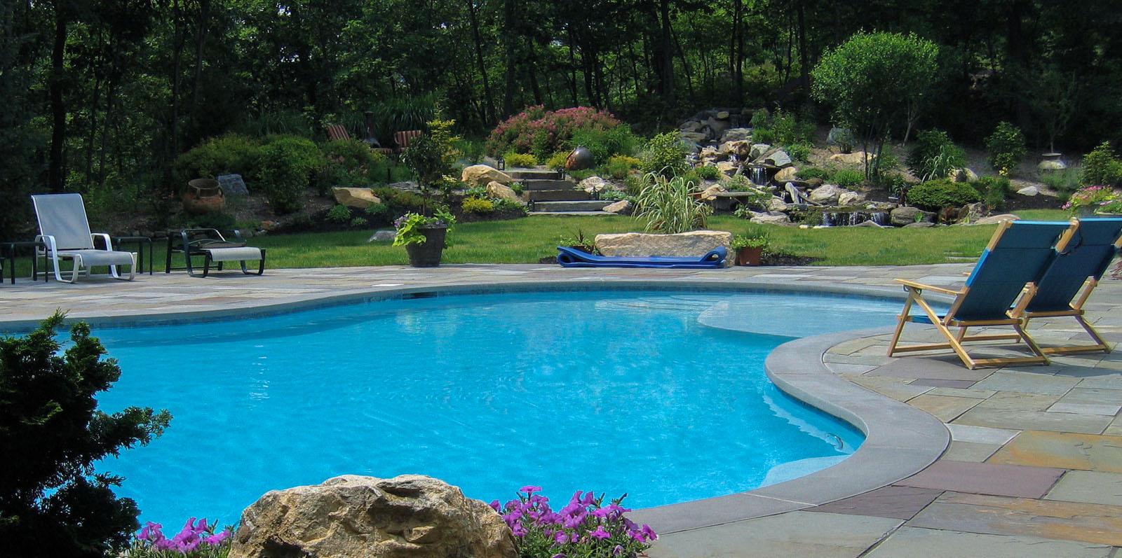 custom gunite swimming pool with bluestone coping and bluestone patio
