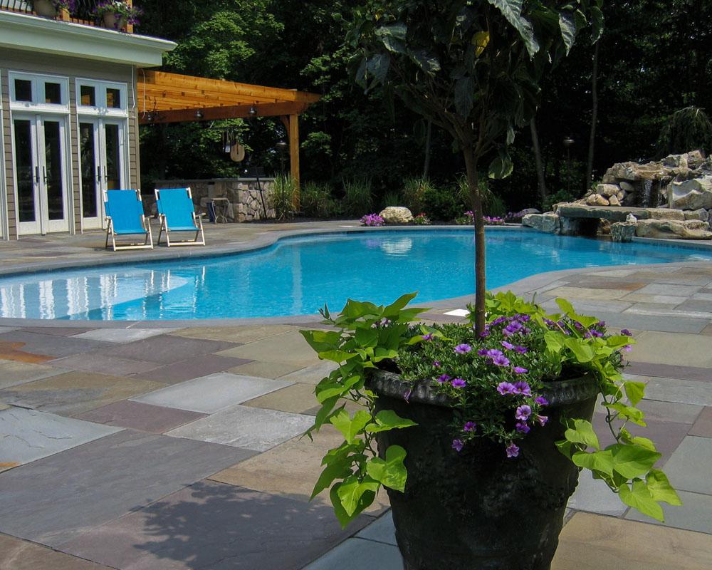 gunite swimming pool with natural stone waterfall