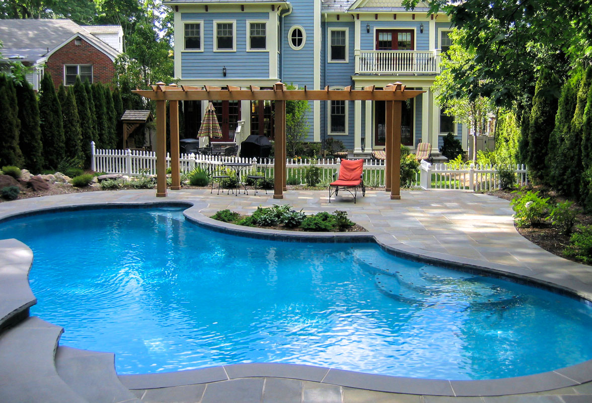 custom swimming pool design with pergola on pool patio
