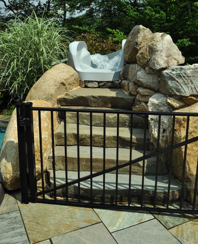 stone slab steps leading to pool waterslide