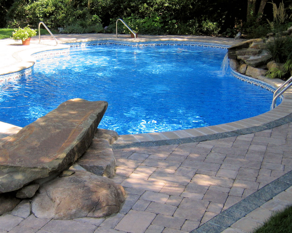 north jersey custom swimming pool with dive rock and pool waterfall