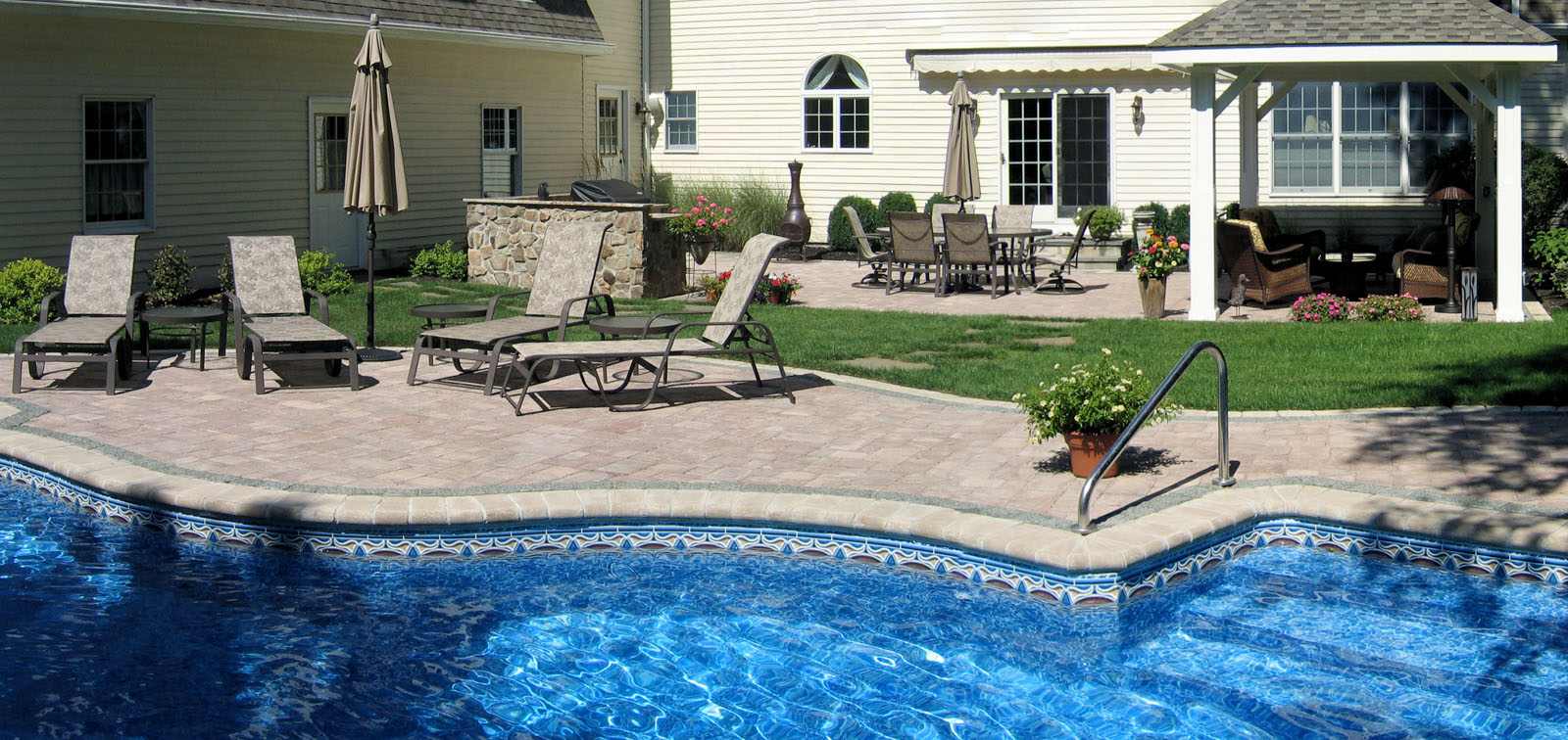 swimming pool with paver patio