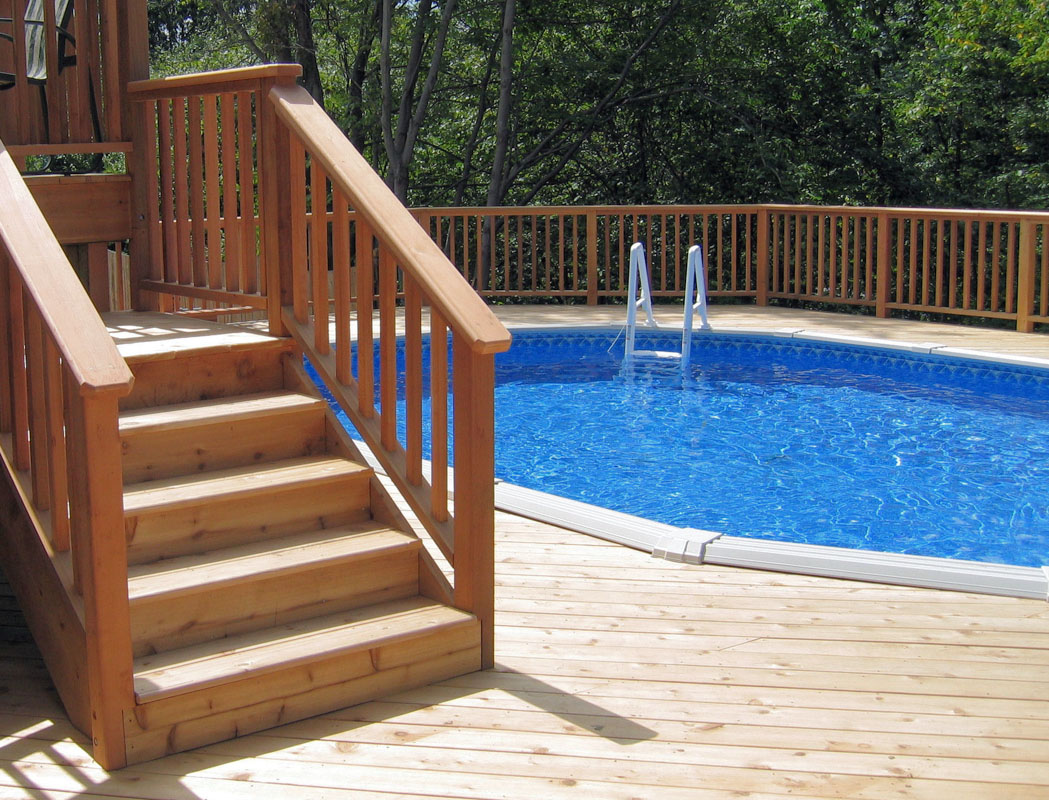 above ground swimming pool built into deck