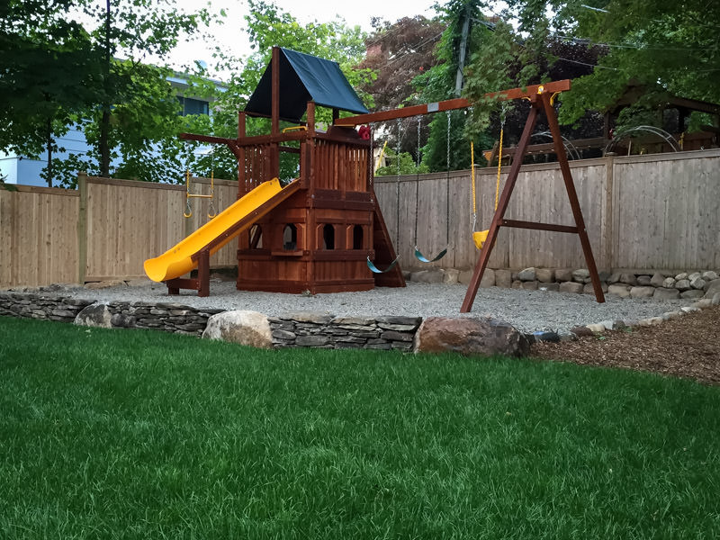 south orange landscaping with play area, lush lawn