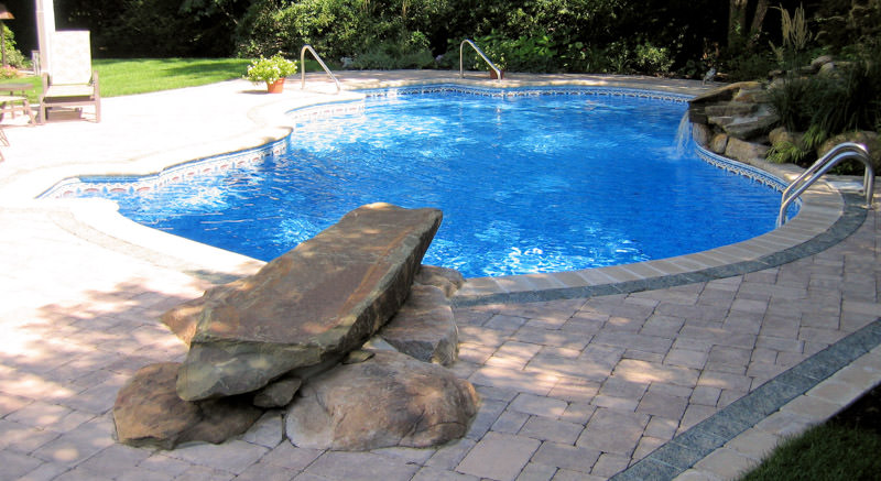 swimming pool with rock diving board in bergen county nj