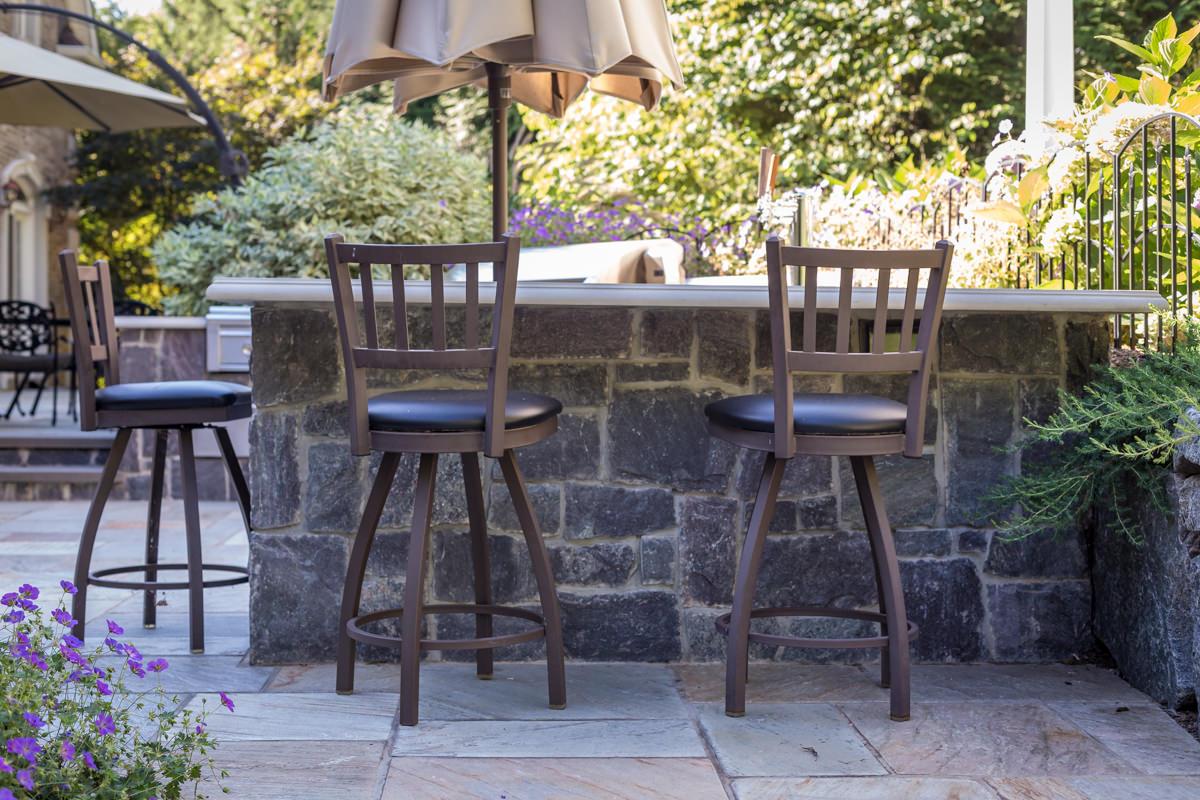 two seats at counter, granite veneer, concrete countertop