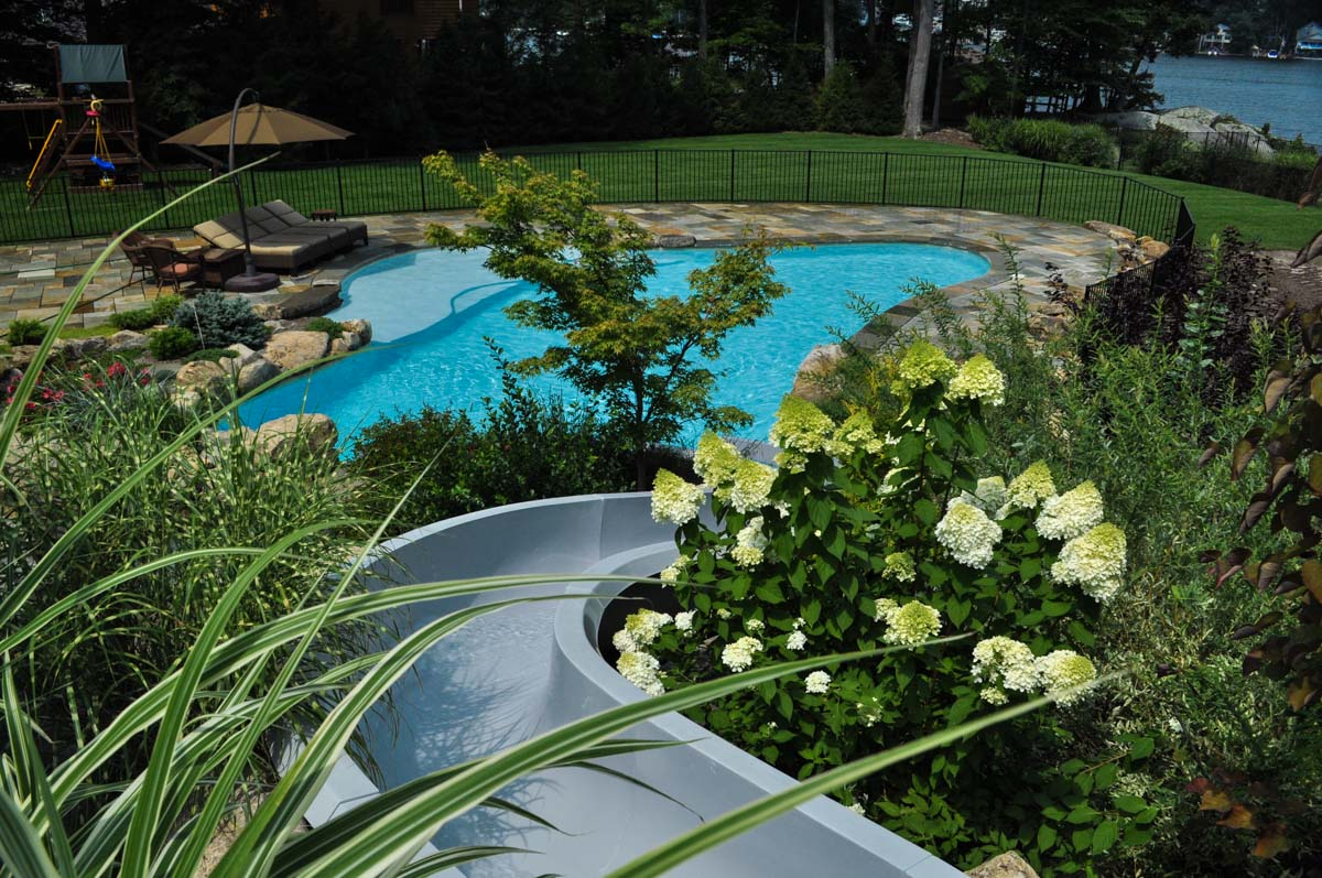 custom waterslide leading to swimming pool