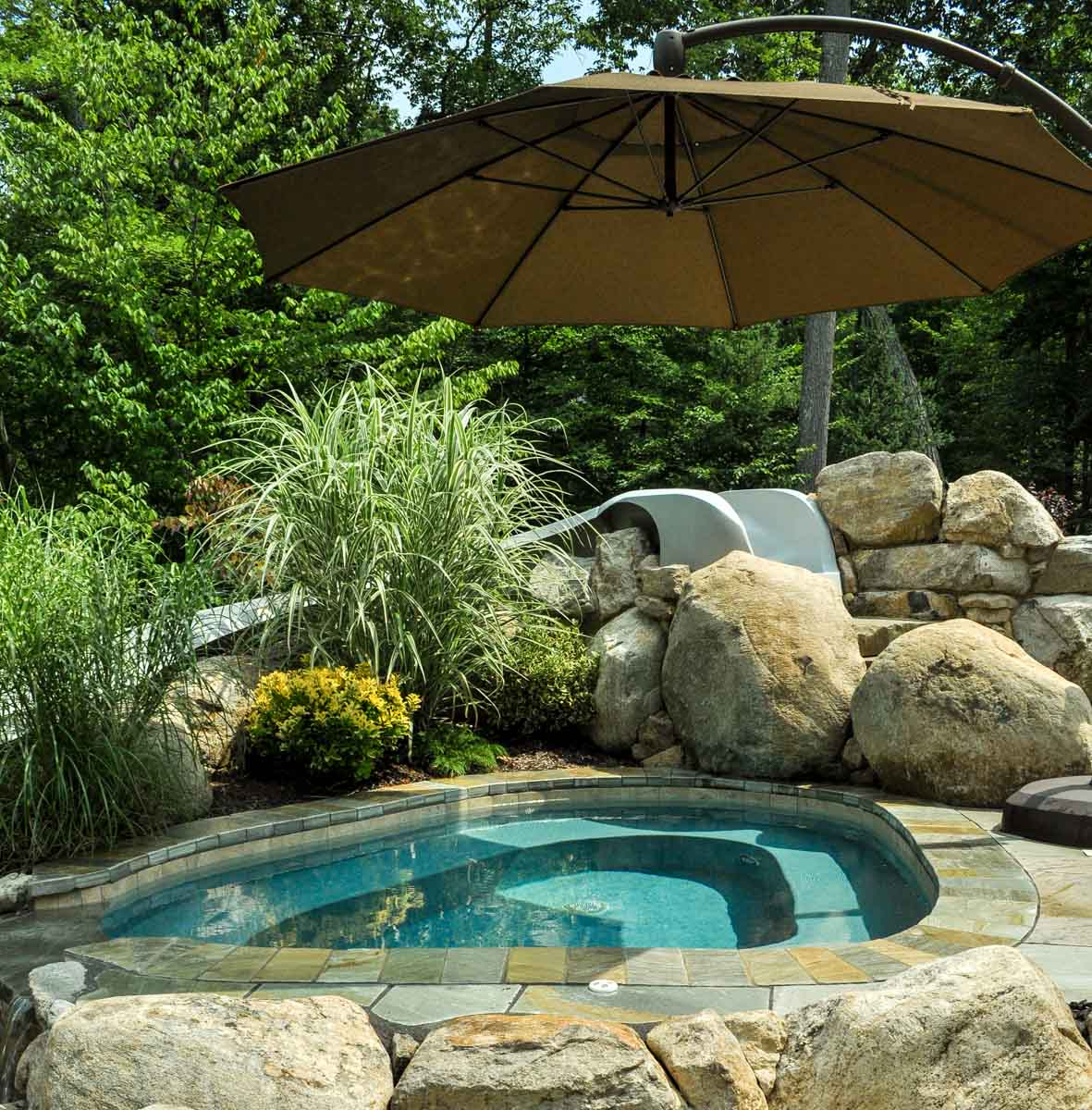 spa with umbrella to provide shade