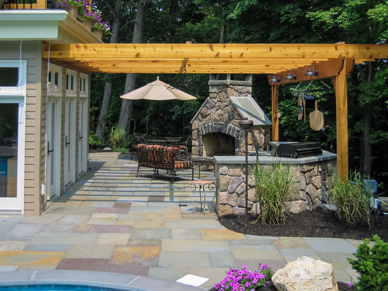 attached pergola with outdoor fireplace in madison nj