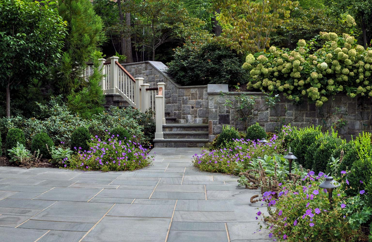 natural stone wall and bluestone patio, before and after landscape pictures