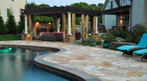 pool, travertine patio, pergola