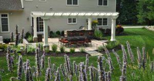 backyard landscape design with paver patio and custom white pergola - north jersey